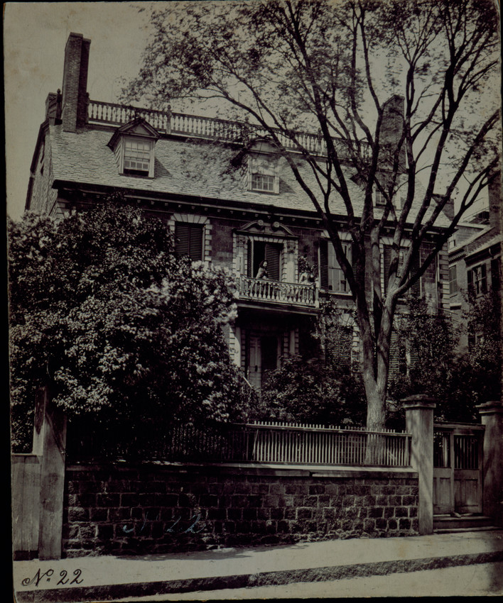 Exterior view of the Hancock House with two women standing on balcony, Boston, Mass., undated