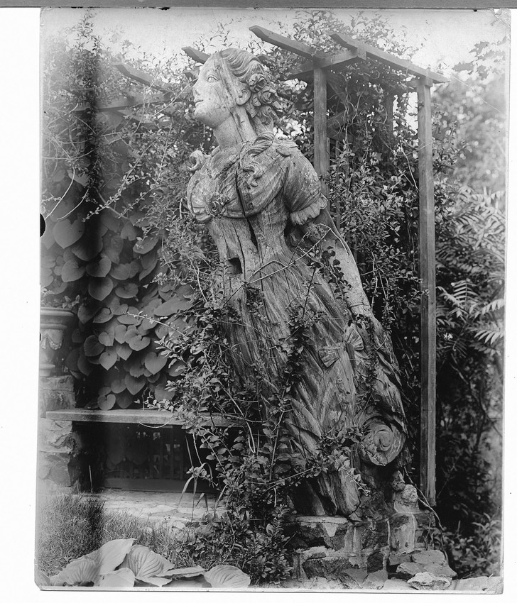 Figurehead on display in a garden, Marblehead, Mass.