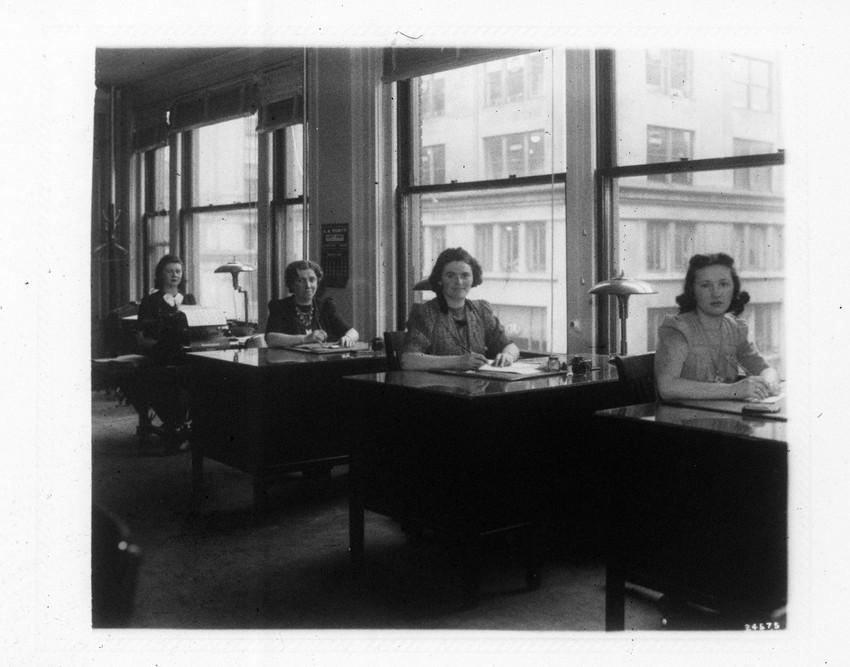 Ladies sitting at their desks